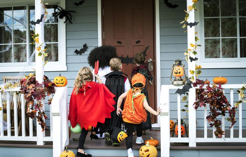 Young kids trick or treating during Halloween royalty free stock images