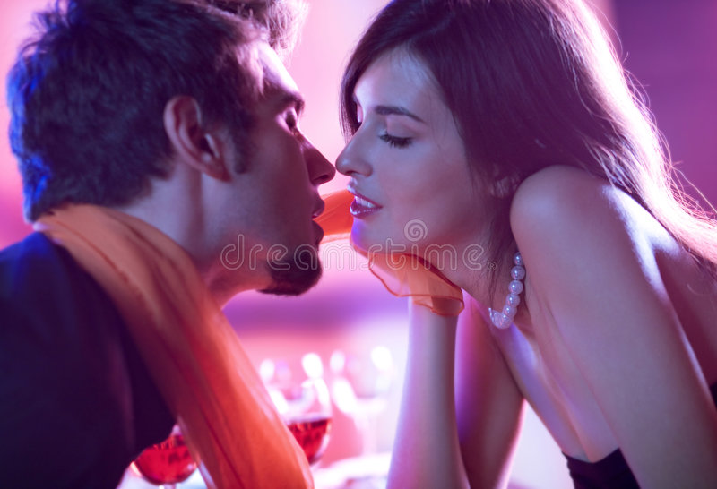 Young kissing couple stock photo