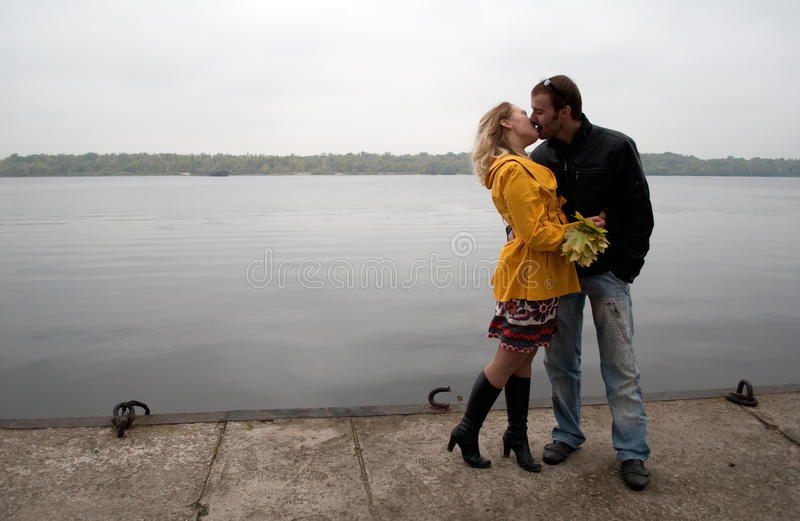 Young kissing couple in love stock images