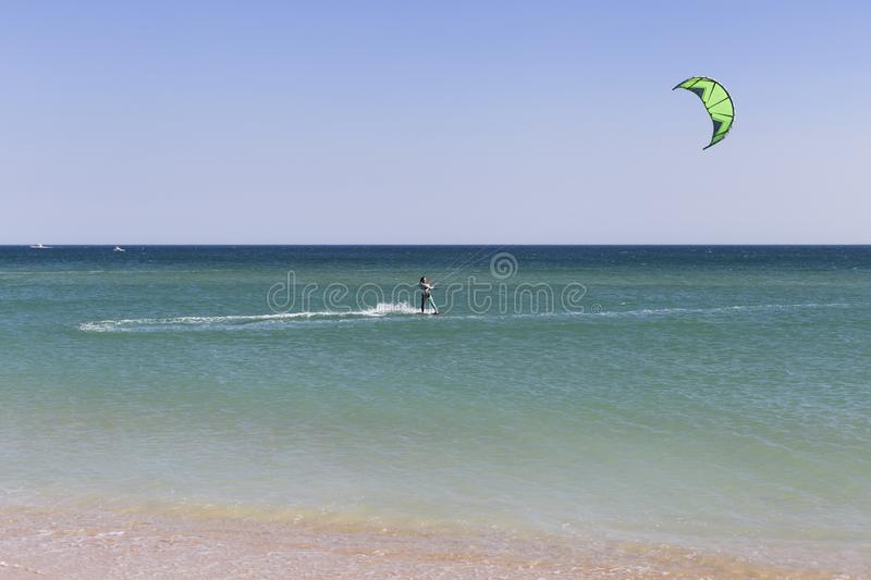 Young kite surfer in waves. Splash. summer. holidays. vacation. sports. lifestyle. Portugal. Wind, fun, surfing, man, boarding, ocean, blue, kiteboarding stock photography