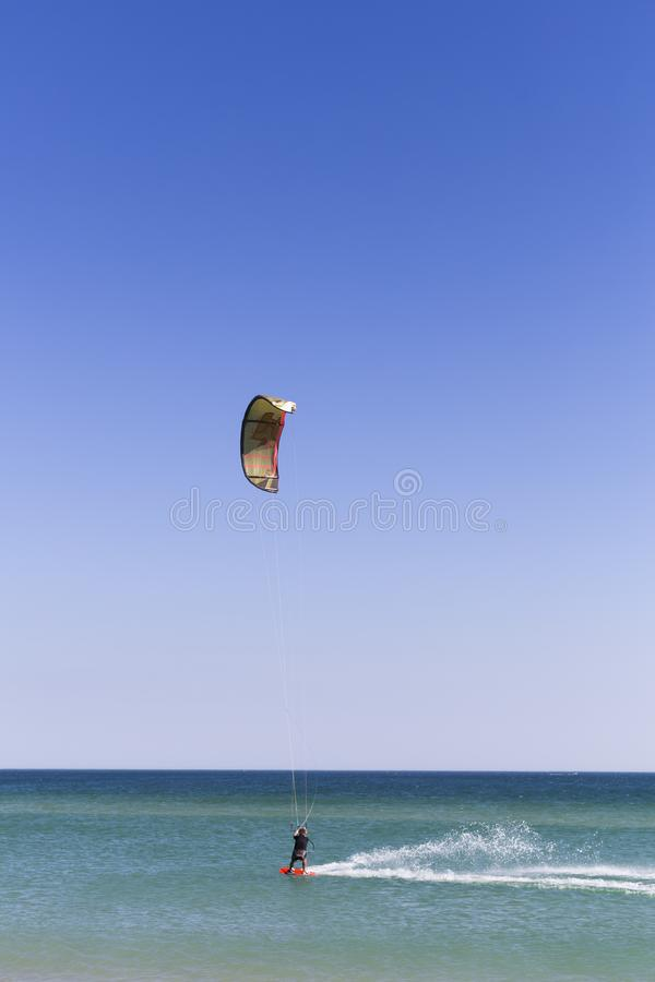 Young kite surfer in waves. Splash. summer. holidays. vacation. sports. lifestyle. Portugal. Wind, fun, surfing, man, boarding, ocean, blue, kiteboarding royalty free stock photography