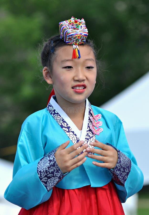 Young Korean Dancer. A young Korean dancer wearing traditional korean clothing (hanbok) performs at Edmonton's Heritage Festival royalty free stock image