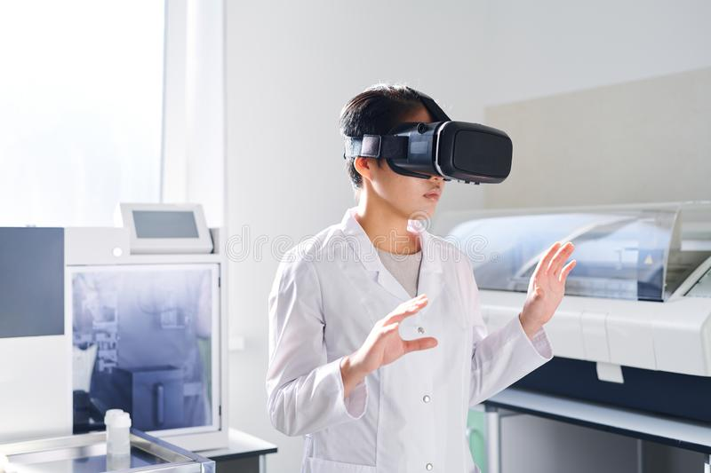 Young laboratory scientist in VR simulator stock images