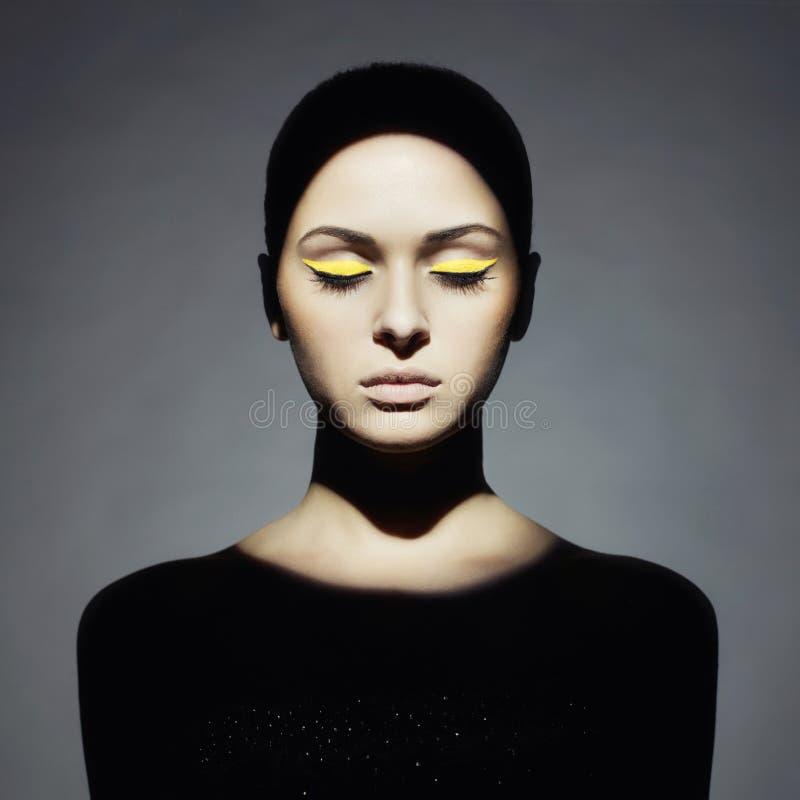 Young lady with art makeup. Surrealist portrait of young lady with art makeup stock photos