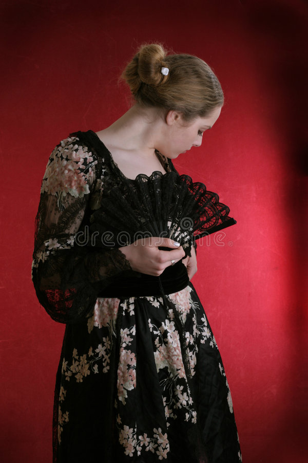 Young lady with black fan stock images