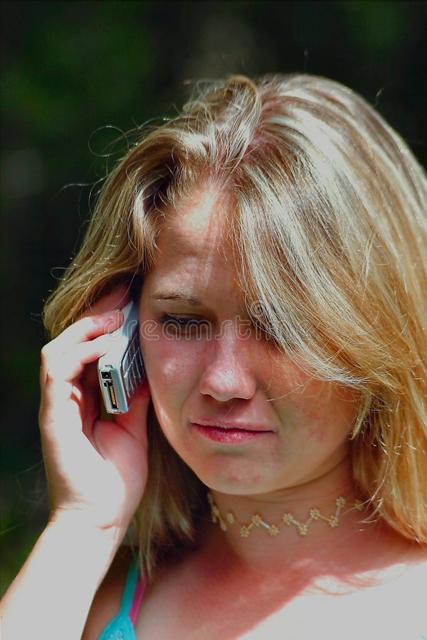 Young lady with cell phone stock photo