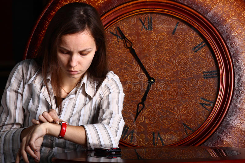 young lady and clock stock photo