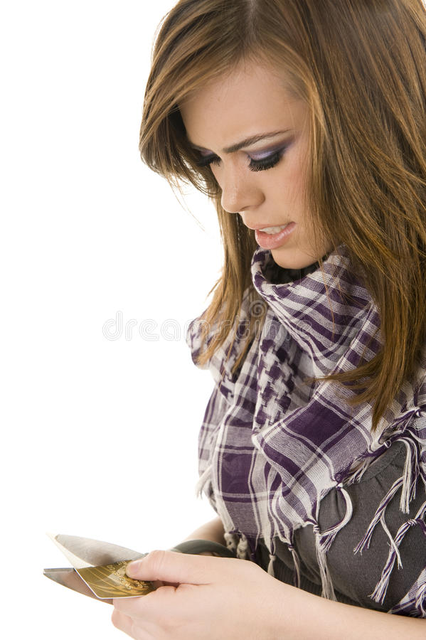 Young lady cutting a credit card stock photography