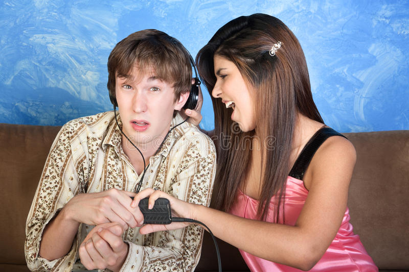 Young Lady Distracts Man Royalty Free Stock Photography
