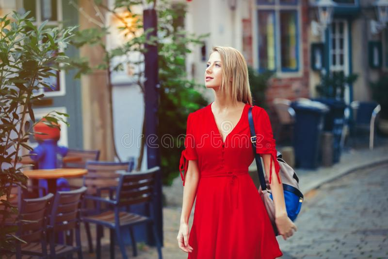 Young lady in dress on medieval street of Bremen royalty free stock photos