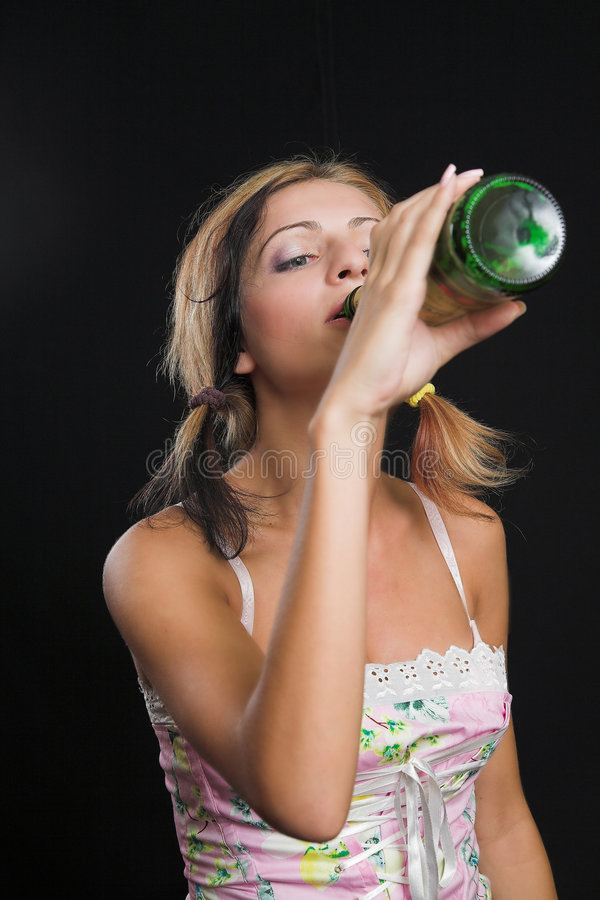 Free Young Lady Drinking From A Beer Bottle Stock Images - 1115374