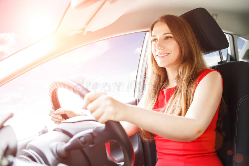 Young lady driving car. Driving school background royalty free stock photo