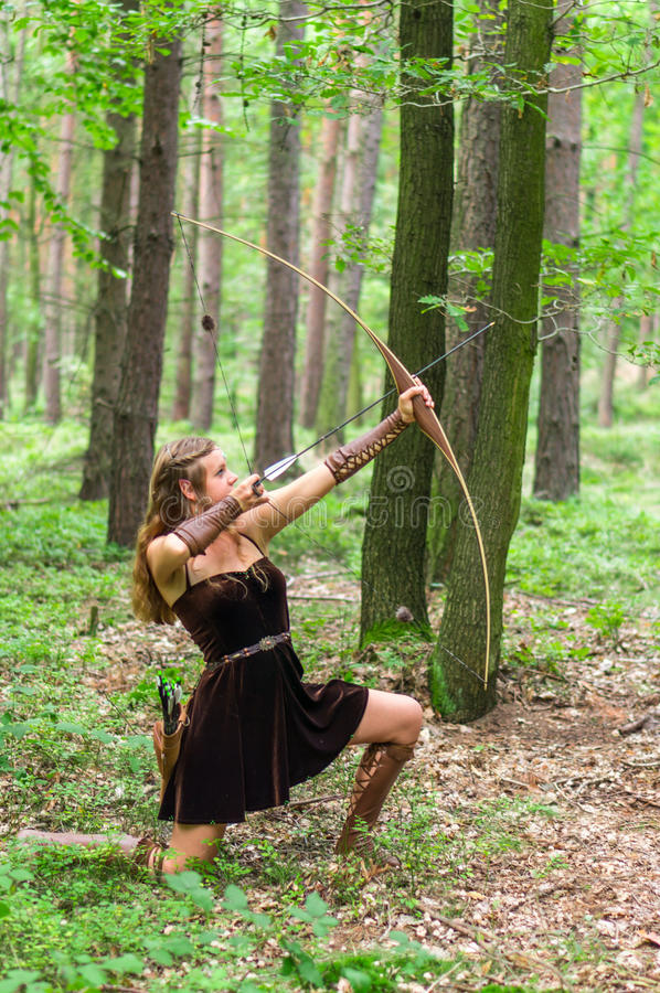 Blonde Female Elf Archer above the Forest Stock Photo
