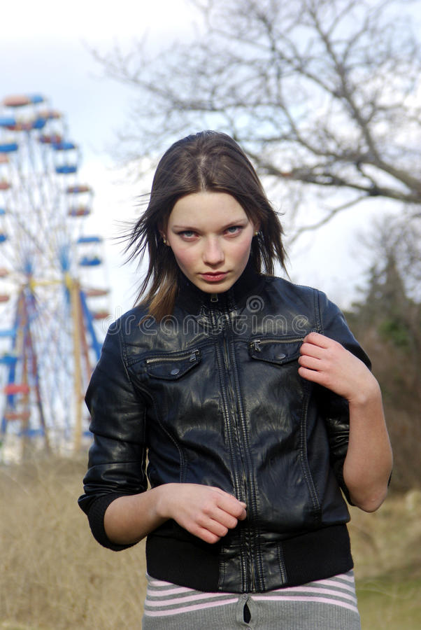 Young lady and a ferris wheel [3] stock photo