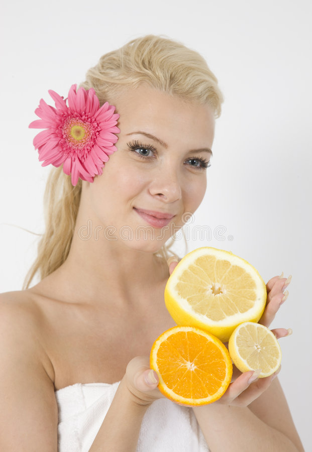 Download Young Lady With Fruits And Pink Flower In Hair Stock Photo - Image: 6275478
