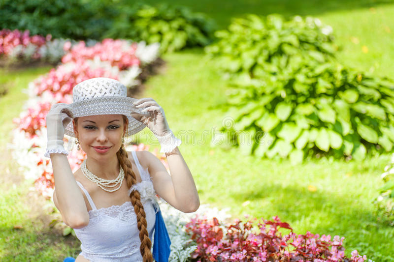 Young lady in garden royalty free stock image