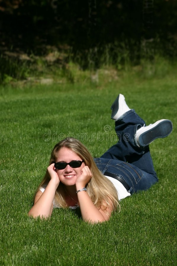 Young lady on grass stock images