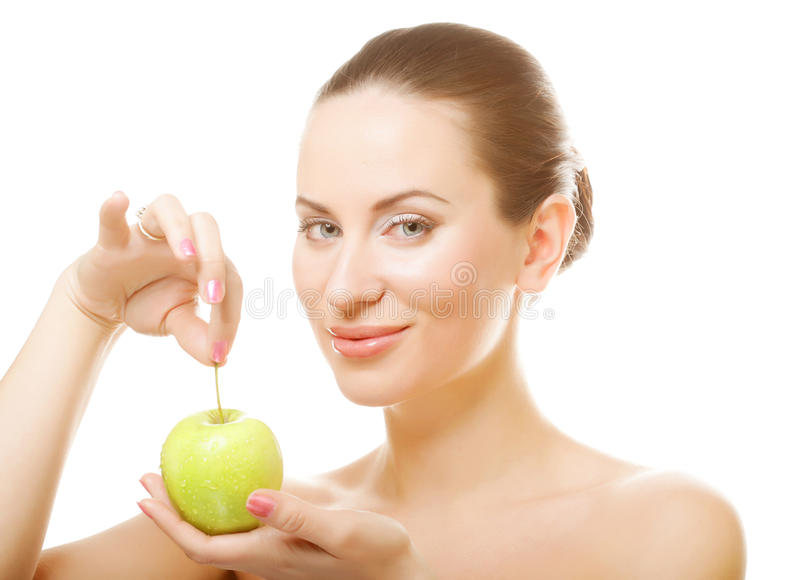 Young lady with green apple. On white background royalty free stock images