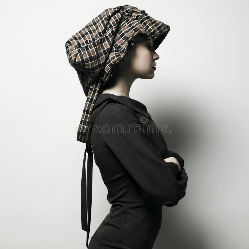 Young lady with hat royalty free stock photos