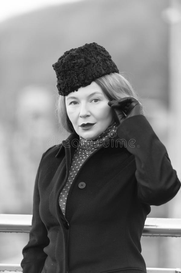 Lady in black hat. Portrait of lade in coat. Air-hostess welcome you. Spring fashion for female. Styled woman black and white phot royalty free stock photos