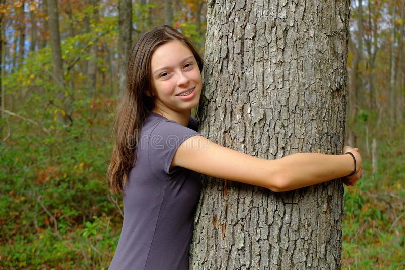 Young Lady Hugging Tree royalty free stock images