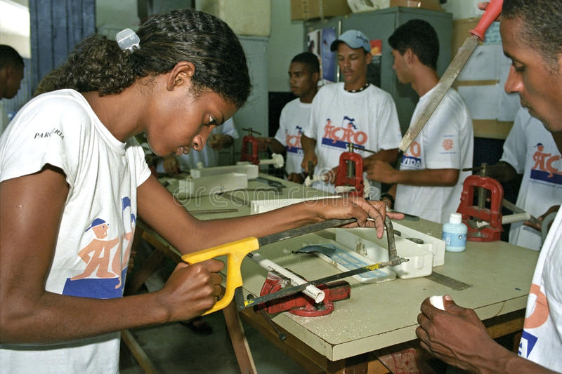 Young lady learns the craft fitter at technical school. Brazil, Pernambuco, Recife city: in the community center or Retome to disadvantaged young people stock images