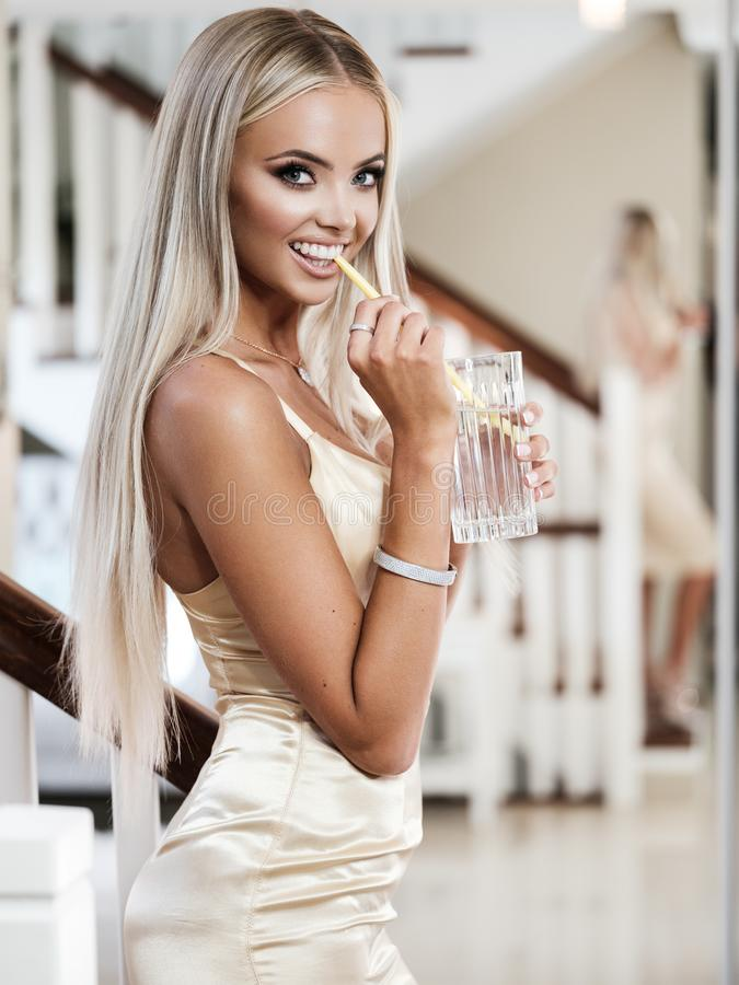 Young lady with luxury jewelry in modern interior royalty free stock images
