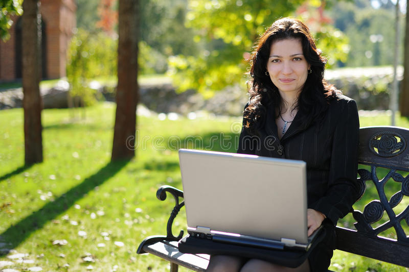 Download Young Lady With A Notebook In A Park Stock Photos - Image: 11563283
