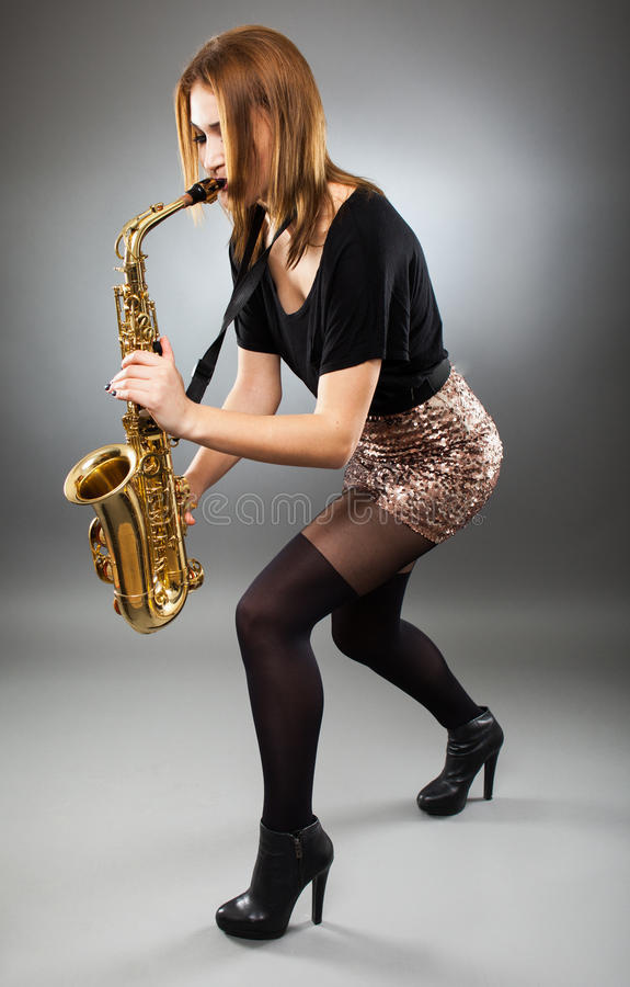 Young Lady Playing The Saxophone Stock Photo