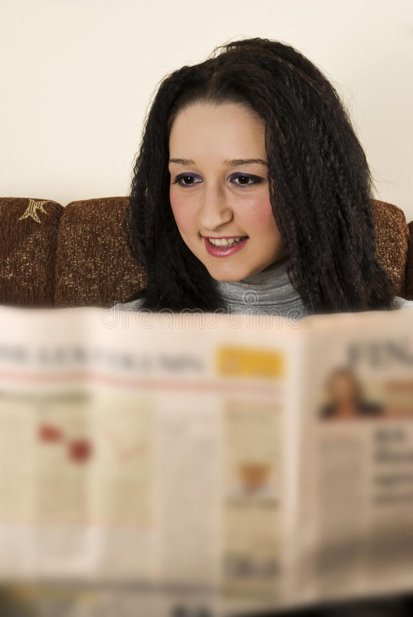 Download Young Lady Read The Newspaper Stock Photography - Image: 12208702