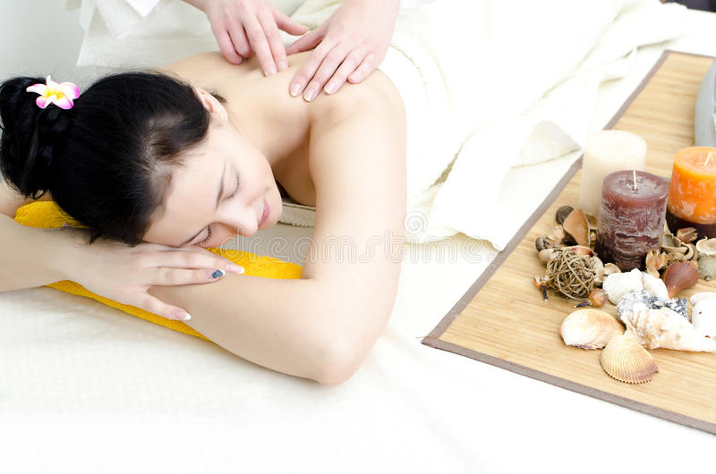 Young Lady Receiving Back Massage Stock Photo