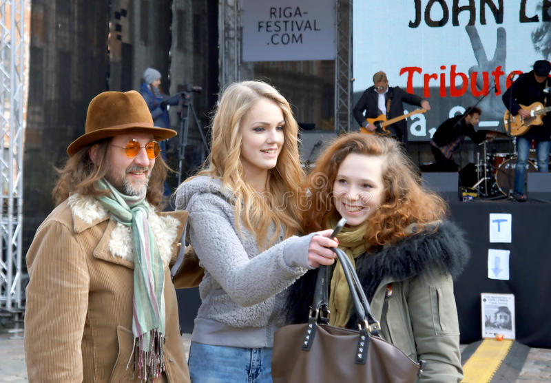 Young lady-singer and organizers of John Lennon 75th Anniversary Riga Festival. Are glad stock photography