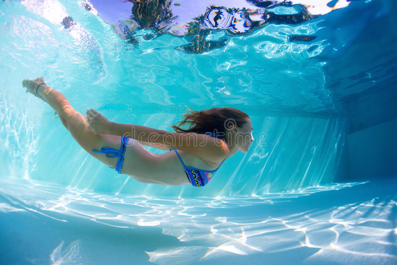 Young lady swimming underwater royalty free stock images