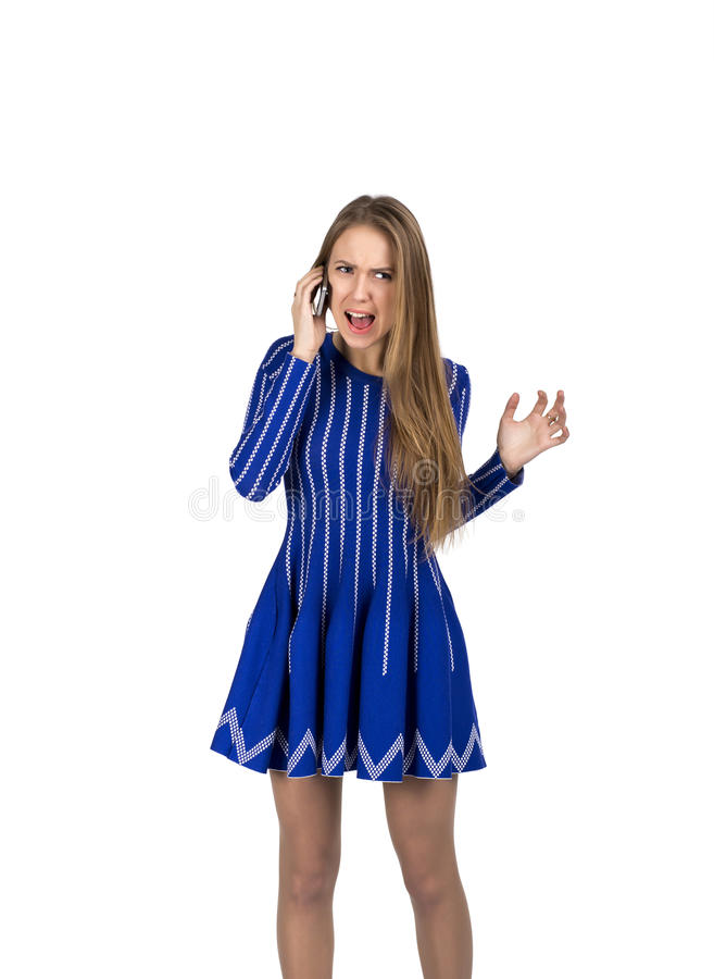 Young lady talking on the phone. Caucasian lady talking on the phone and expressing anger and fury stock photography