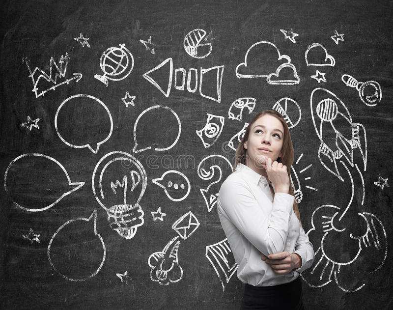 Young lady is thinking about optimisation of the marketing business process. Social media icons are drawn on the black c. Young beautiful lady is thinking about stock image