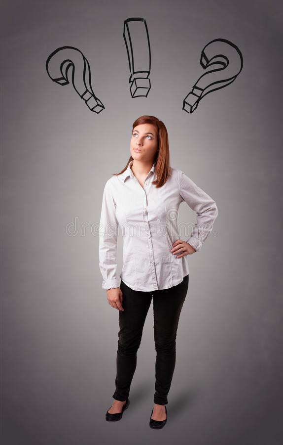 Young Lady Thinking With Question Marks Overhead Stock Photo