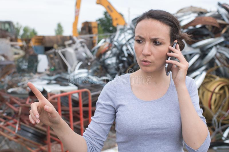 Young landfill manager on phone stock photography