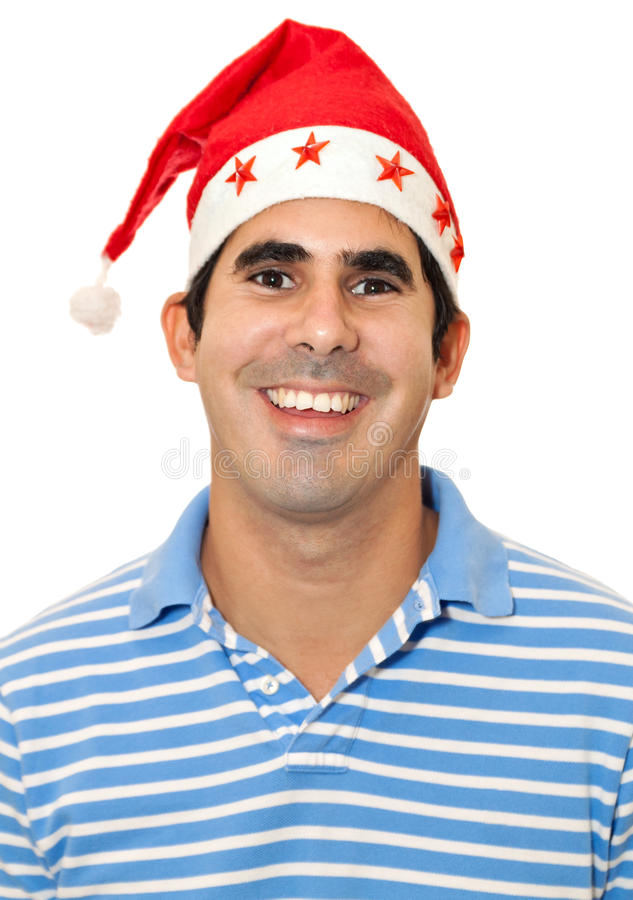 Young Latin Man With A Red Santa Hat Royalty Free Stock Photos