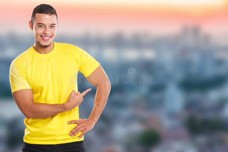 Young latin man showing pointing marketing town ad advert people copyspace copy space. Ads royalty free stock images