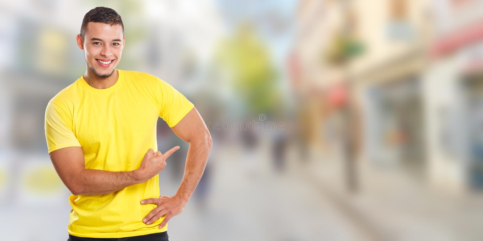 Young latin man showing pointing marketing town ad advert people copyspace copy space banner. Ads stock images