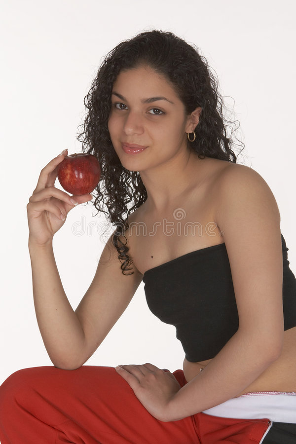 Young Latina with Apple royalty free stock photos