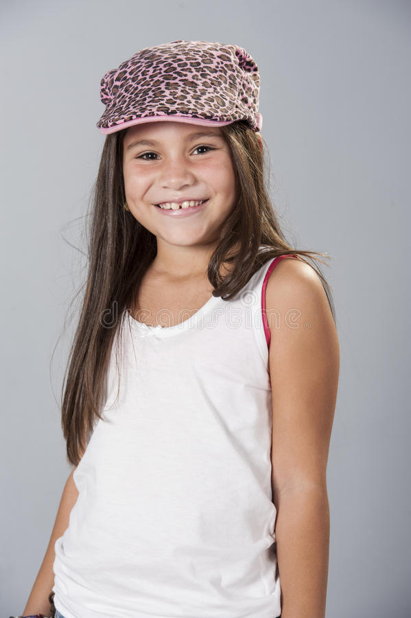Young latino girl posing in studio stock images