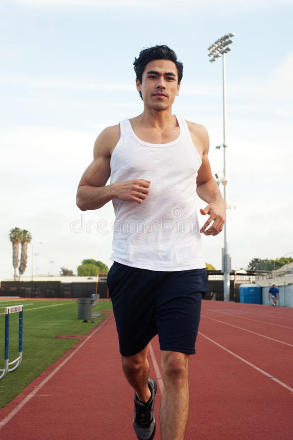 Young latino male athlete, running stock image