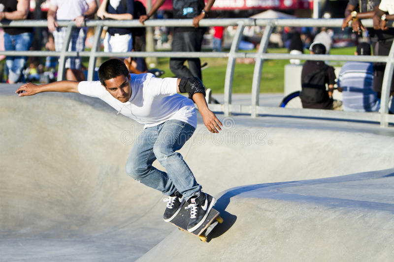 Young Latino Male Performing At Skateboard Par stock photography