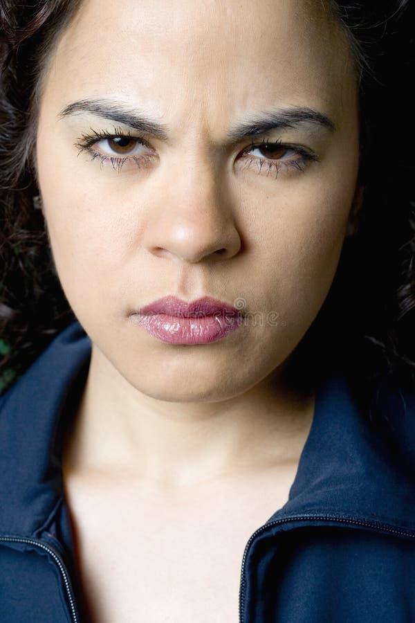 Young Latino woman angry stock photos
