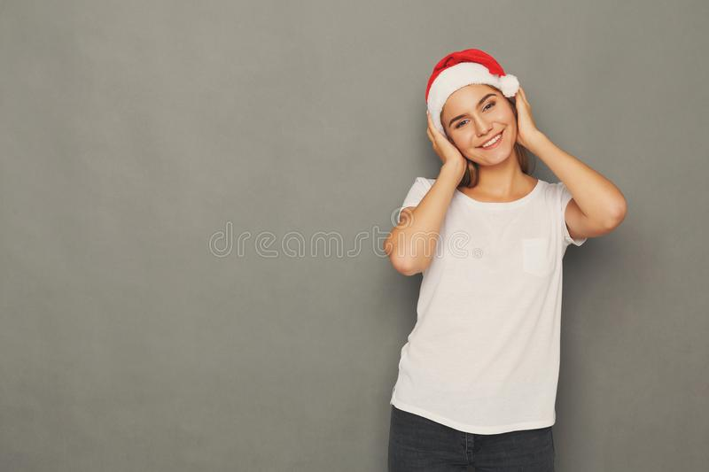 Young laughing attractive woman in santa hat stock image