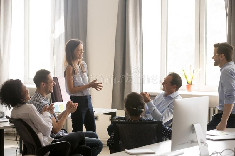 Young female coach, leader having fun with employees, office wor royalty free stock image