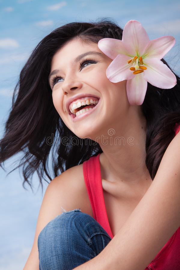Young Laughing Girl Lilium royalty free stock photography