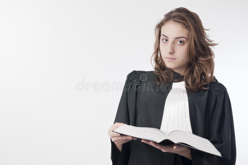 Young lawyer. Young law school student holding the statute book stock images