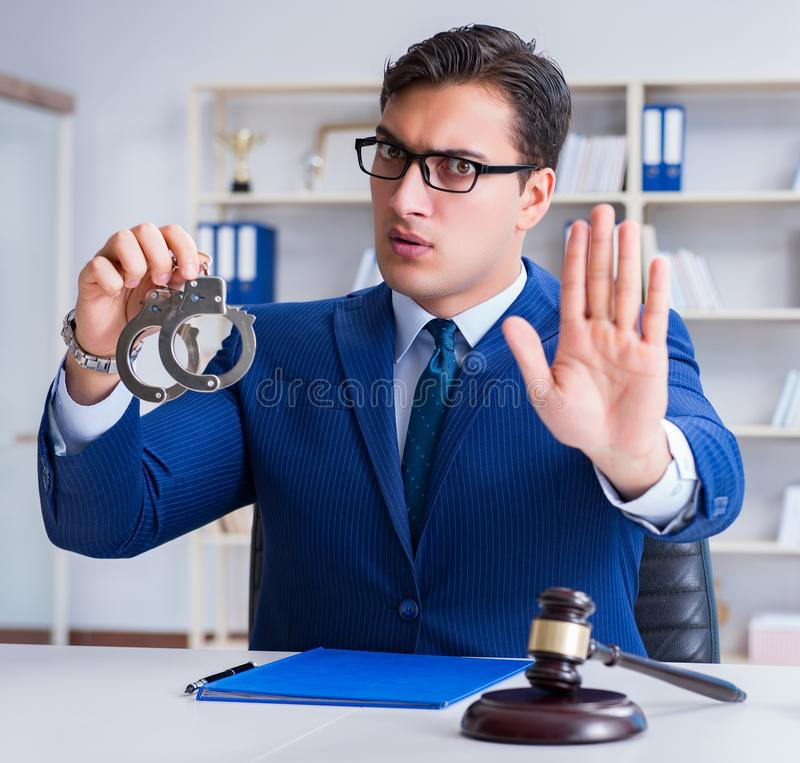 Young lawyer judge sitting in the office. The young lawyer judge sitting in the office royalty free stock image